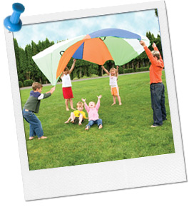 Photo of Children and Adults Playing with a Parachute